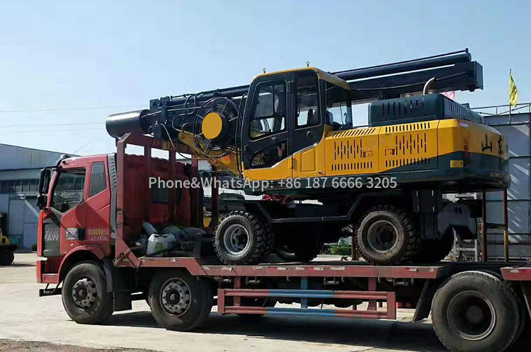 Transport picture of full swing hydraulic wheel rotary drilling rig