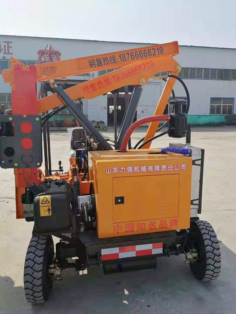 Picture of Tired Highway Guardrail Pile Drilling Machine