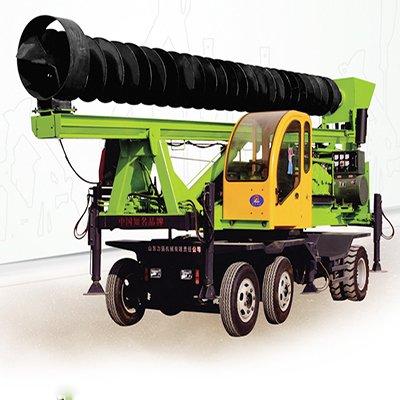 Wheeled screw pile drill