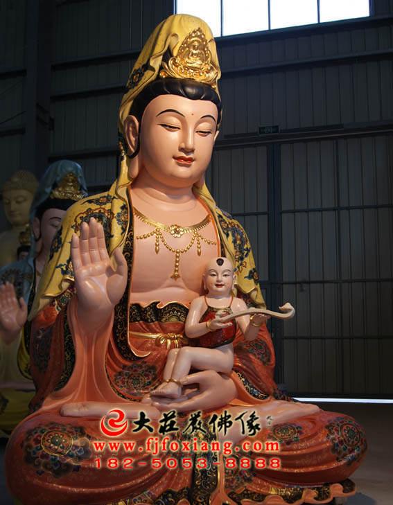 铜像送子观音侧面近照彩绘塑像