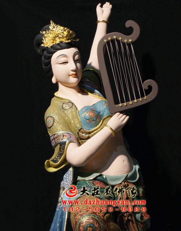 铜像箜篌伎乐天彩绘神像正面近照