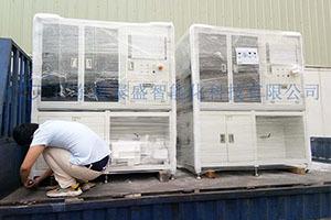 江苏某企业全自动3C辅料贴胶机设备案例