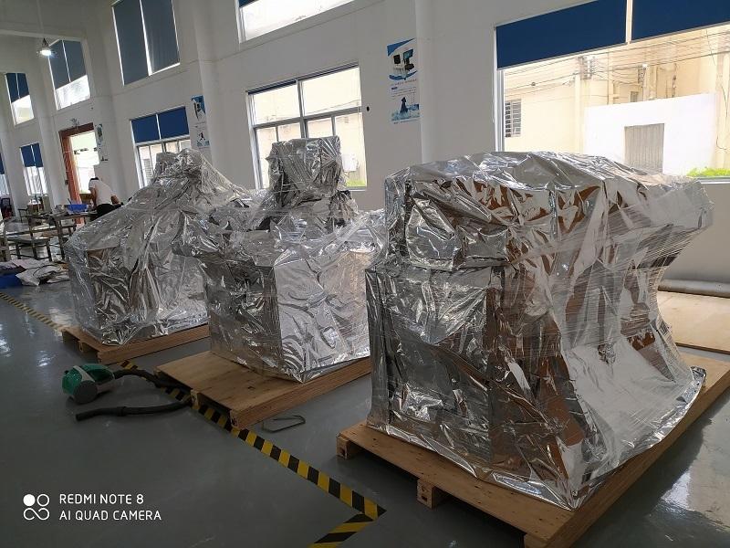 【口罩机出货】秦泰盛KN95折叠口罩机和平面一拖二口罩机发货美国打包流程