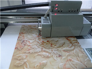 Flatbed printer suitable for printing tiles