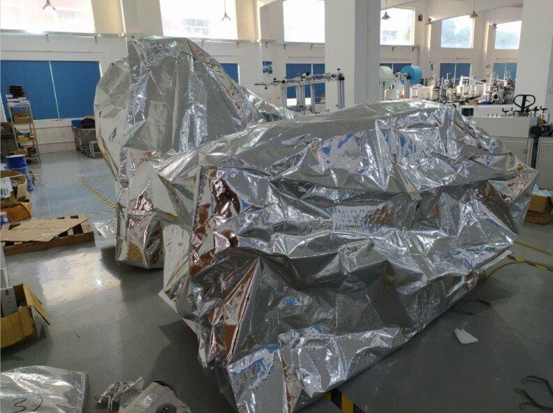 秦泰盛全自动口罩机出口海外抽真空包装图片