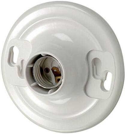 Plastic keyless lamp socket with twist lock mounting white