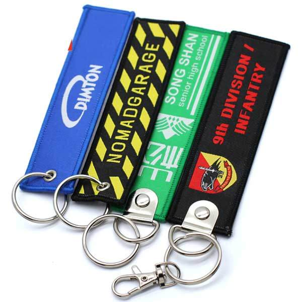 Custom Brand Name Travel Souvenir Woven Embroidery Logo Fabric Keychains