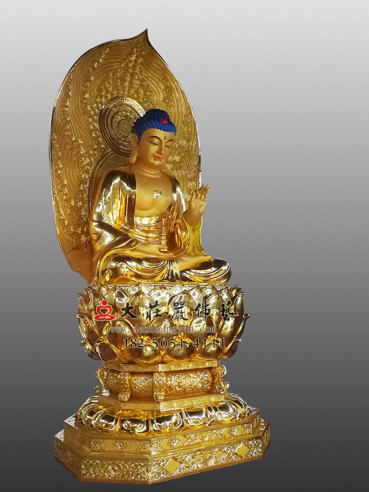 铜雕药师佛左侧贴金佛像