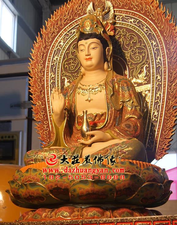 铜雕观音菩萨侧面近照彩绘塑像