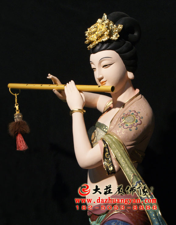 铜像笛子伎乐天彩绘神像侧面近照